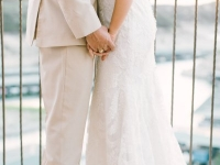 bride_groom_embrace_rough_hollow_yacht_club_lakeway_austin_texas_pavilion_wedding