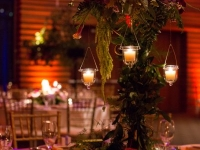 dinner-table-votive-and-uplights-lighting-with-forals-wedding-reception-Leslie+Harry